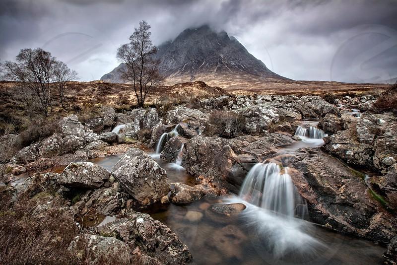 white stream with grey rocks near volcano photo