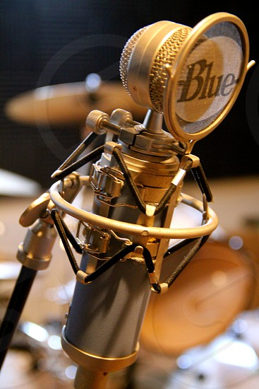 "In studio with a high-end ""blue"" microphone.  photo"
