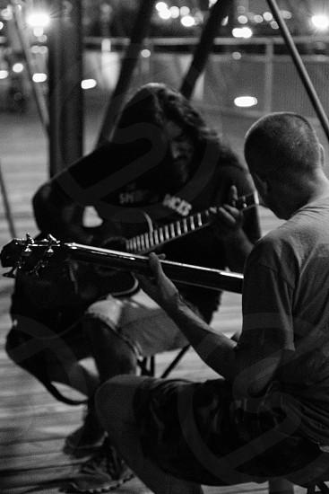 music musicians guitar jam acoustic bridge demographic modern urban gritty street life city grungy edgy industrial steel photo