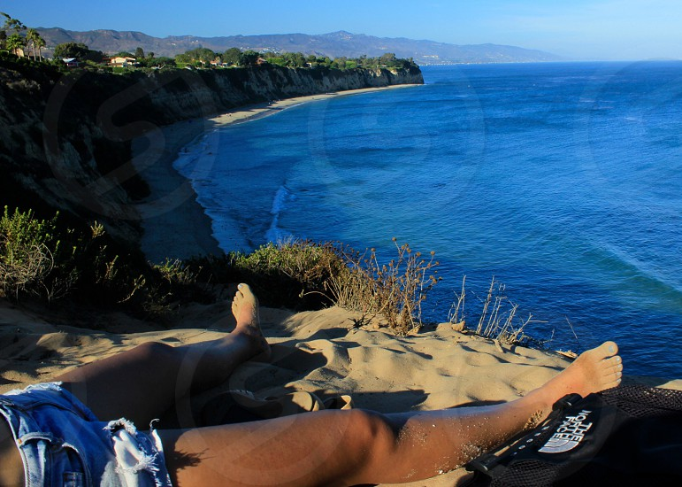 Relax view legs ocean water Malibu California  photo