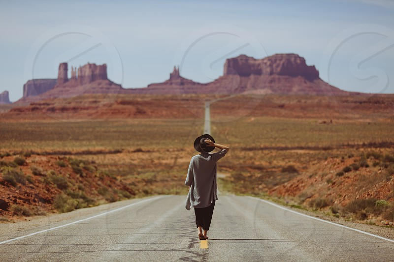 The ways we travel monument valley utah arizona girl hat walking rocks red purple green landscape scenery backpacking nomad fashion travel adventure leisure backpacking window death valley state usa nomadic mountain car road driving drive road trip photo