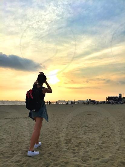 Beach sunset snap photographer traveler travelers sand outdoor  photo