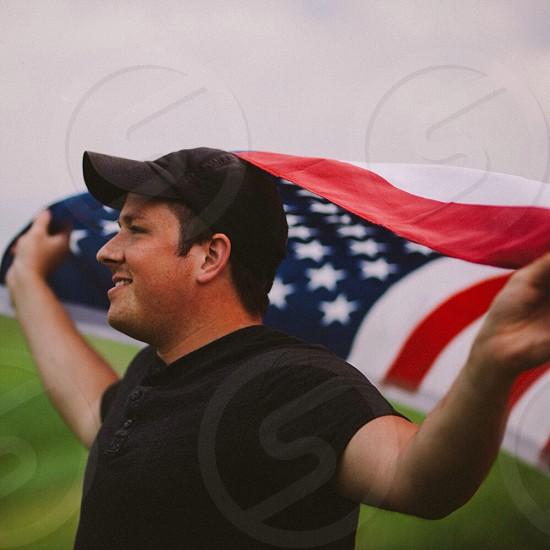 man holding us flag photo