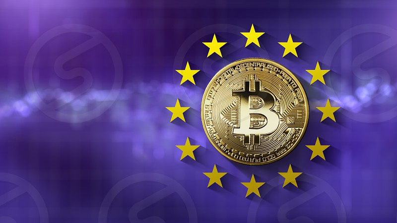 bitcoin Gold coin with European Union stars on the ultraviolet background of the blurred screen of the trading schedule. Regulation and sale of bitcoins at EU level. Cryptocurrency trading concept. Can be used for video or site cover photo