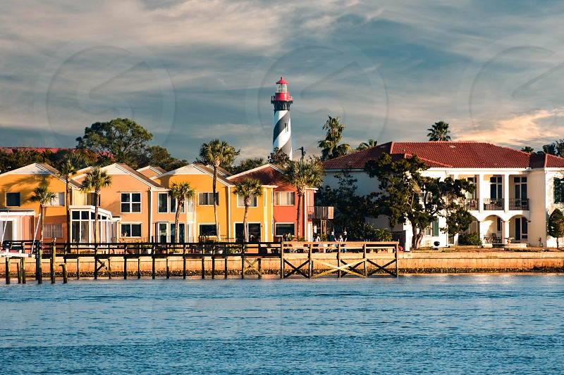 St. Augustine Florida. January 26  2019. Old Lighthouse and colorful dockside on cloudy sky background in Florida's Historic Coast photo
