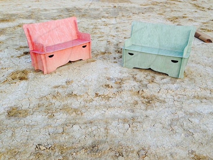 pink bench pale blue bench in the desert playa photo