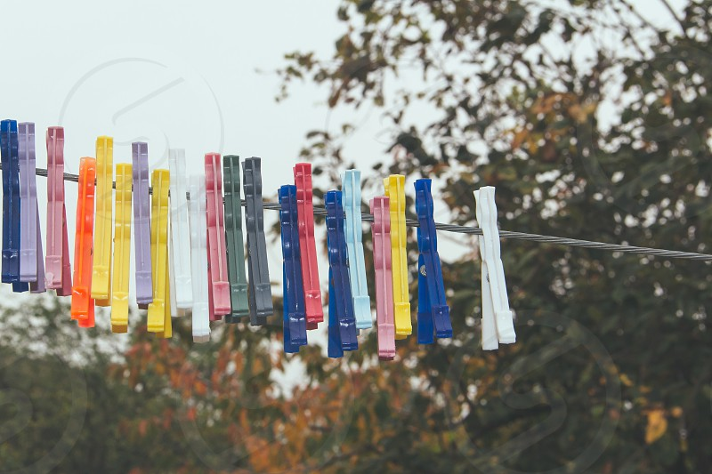 Outdoors clothesline with coloured clothespins photo
