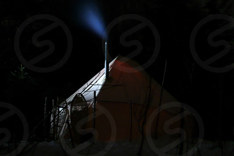 Traditional canvas tent in winter. Smoke rising from the chimney.  photo