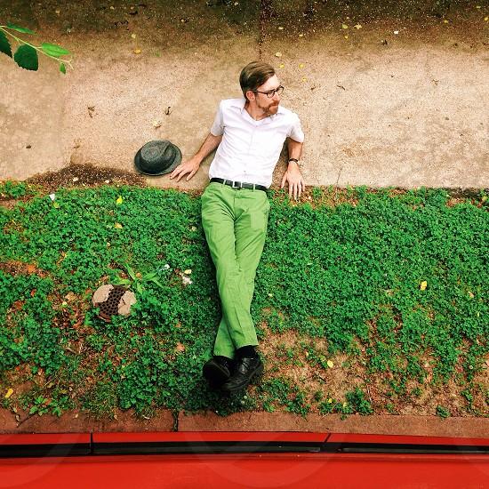 man sitting on ground photography photo
