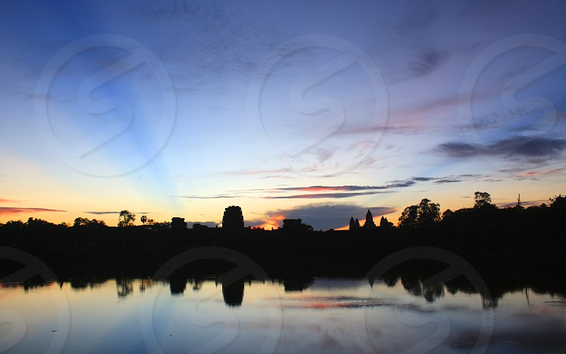 angkor wat cambodia temple sunrise water religion photo