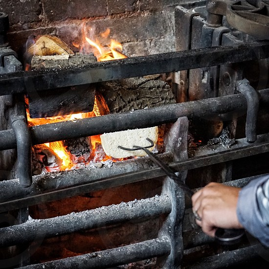 Toasting bread on an open fire photo