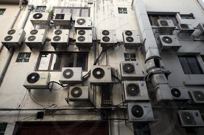 aircondition on a building in the city of Singapore in Southeastasia. photo