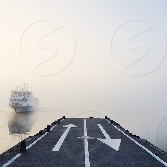 boat appearing out of the fog photo