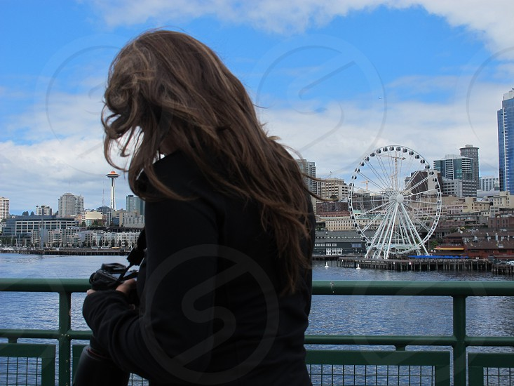 Waterfront in front of Space Needle and carousel in Seattle WA photo