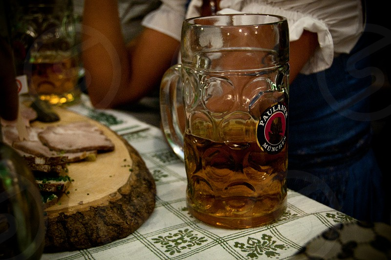 A half-full litre of beer at Oktoberfest in Munich. photo