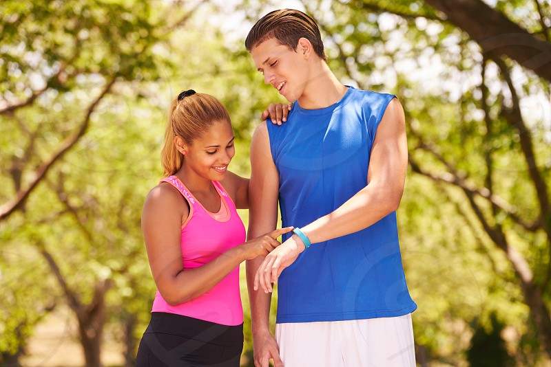 fit; watch; running; sports; jogging; woman; girl; man; activity; athletes; body; bracelet; counter; couple; equipment; exercise; exercising; fitwatch; fitband; fitness; fitwatch; happy; health; heart; heart beat; hispanic; jogger; latin; leisure; looking; outdoor; people; persons; rate; run; runner; smartwatch; smiling; sport; sporty; steps; talking; technology; time; tracker; training; wearable; working out; wrist; young photo