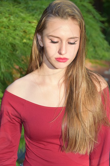 Vibrant color: pretty girl candid in red photo