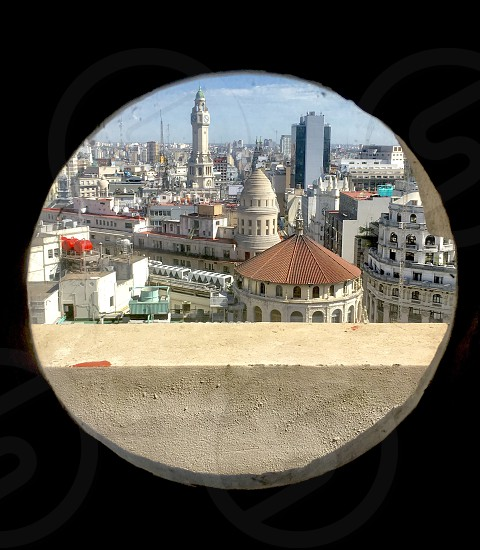 Round circle window frame Buenos Aires Capital south America cityscape domes architecture European day Argentina buildings old sky clear skyline photo