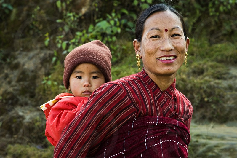 Nepali Woman and her Child - The population of Nepal is a mosaic of diverse ethnic groups including the Thakali Tamang Newar Sherpa Tibetan and Gurung.  This is a meeting place of Indo-Aryan peoples from the Indian subcontinent as well as the Mongoloid people of the Himalaya regions. photo