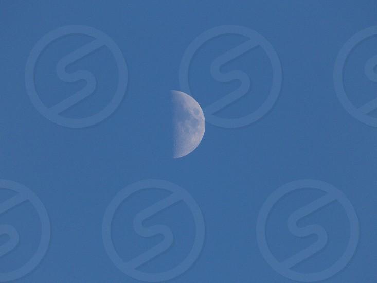 Half moon blue sky twilight  photo