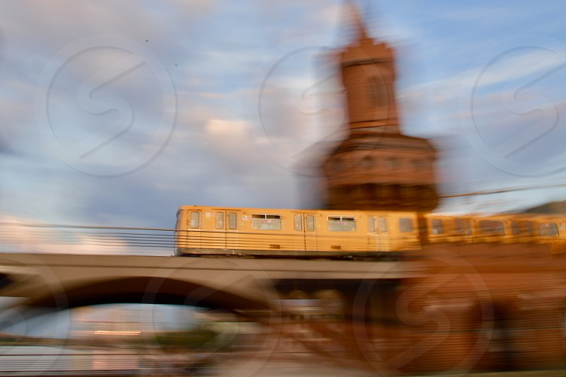 Berlin subway moving over Oberbaum bridge motion blurred photo