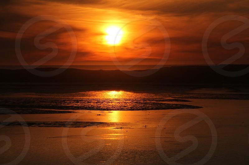 sunset on seashore view photo