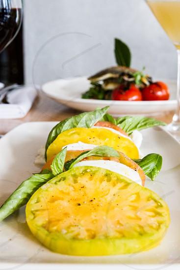 cherry tomatoes on white ceramic plate photo