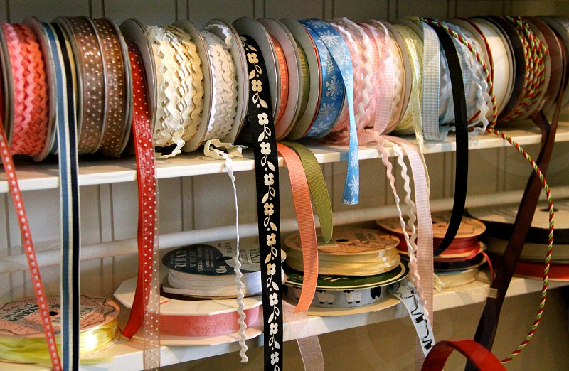 Strung out - a spool of many ribbon spools spun up together. photo