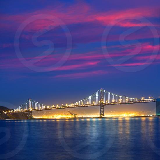 San Francisco Bay Bridge at sunset from Pier 7 in California USA photo