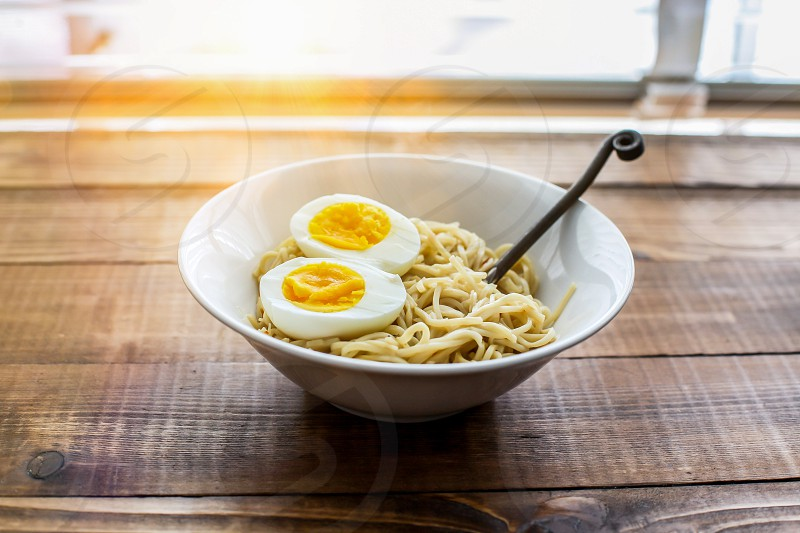 Ramen noodle with eggs and sunbeam from outside photo