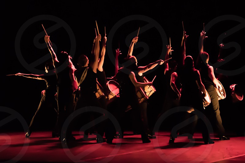 Drummers performance stage dance red Latin silhouettes photo