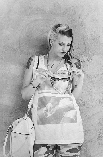 drawing of girl in white tank top white leather bag striped hair gold chain necklace photo