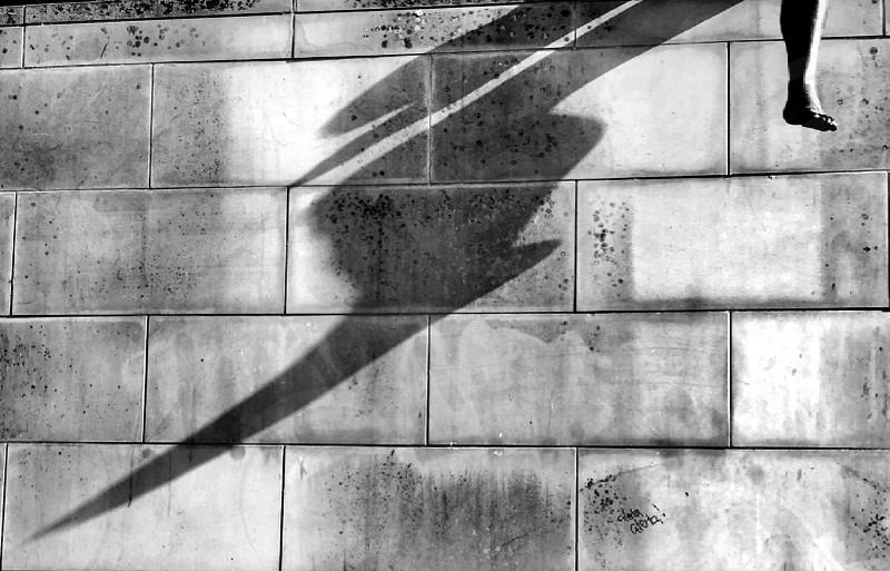 Long shadow cast by statue leg in Berlin  photo