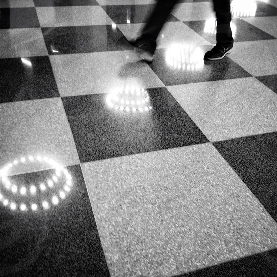 circle tile checker step walk black and white B&W lights reflection floor terrazzo blur movement rings concentric  photo