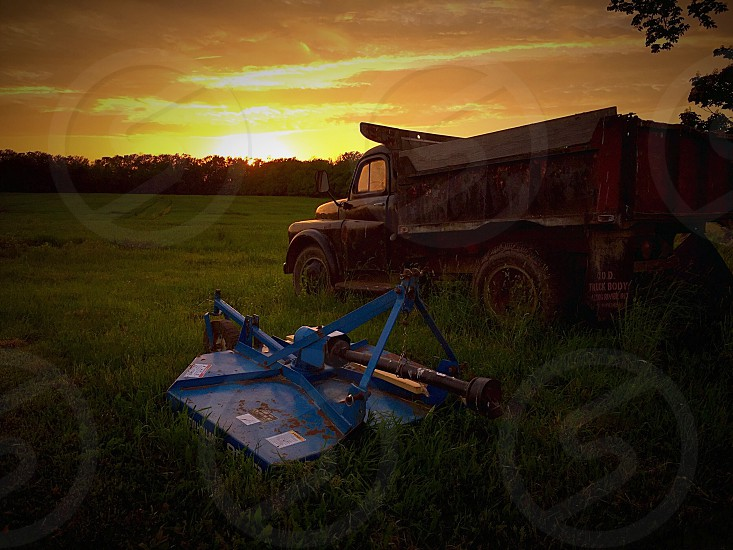 Dump truck in front of farm land at sunset in Western New York photo