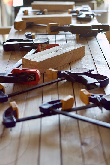 Woodworking tools on the surface of a workbench in natural light photo
