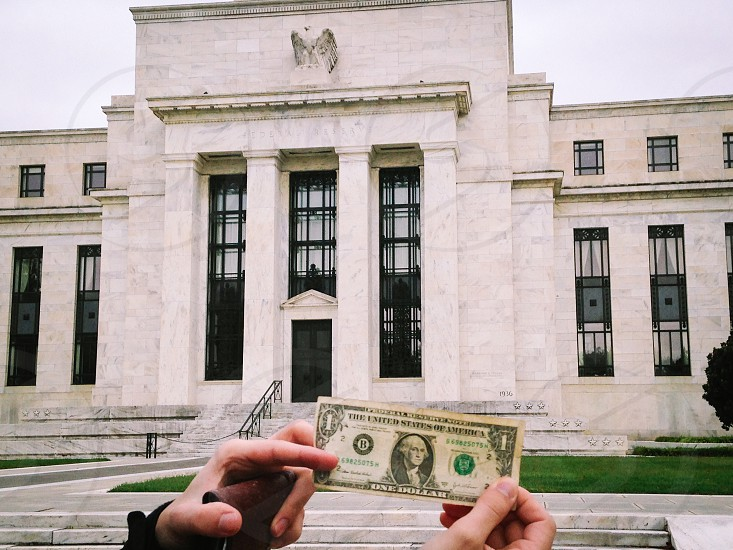 Federal reserve bank and a dollar bill 🙌 photo