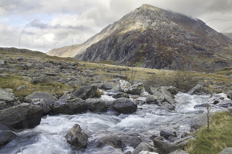 Water flows down towards Pen-yr-Ole Wen Snowdonia North Wales (UK). photo