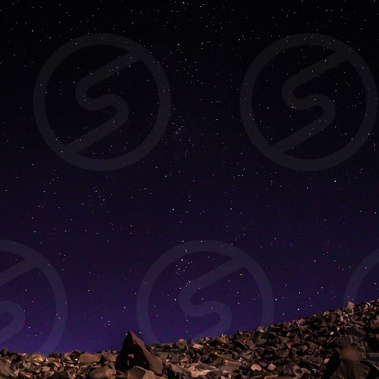brown rock under sky with stars photo