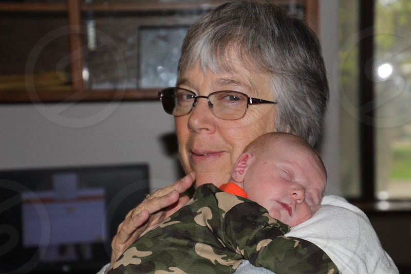 Snuggle time with Grandma photo