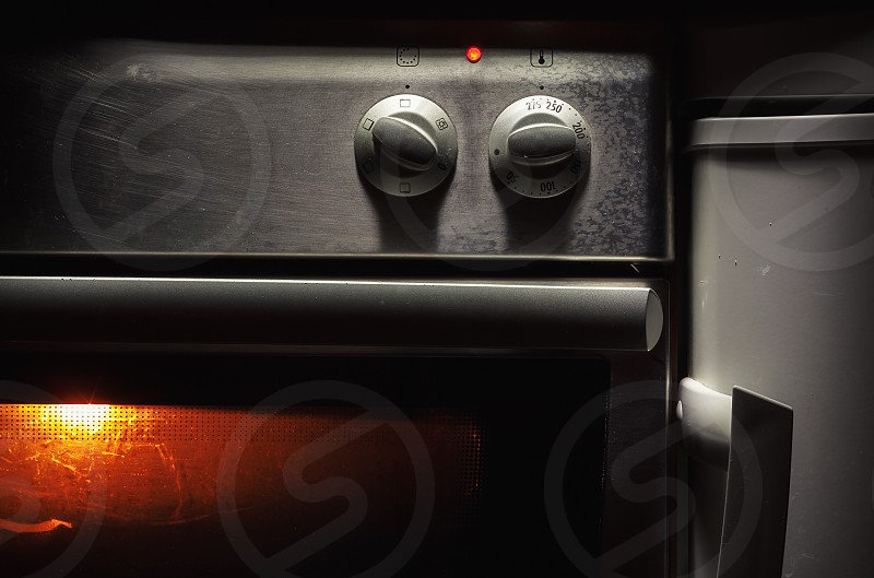 Closeup view on oven control buttons for heat and temperature.  photo