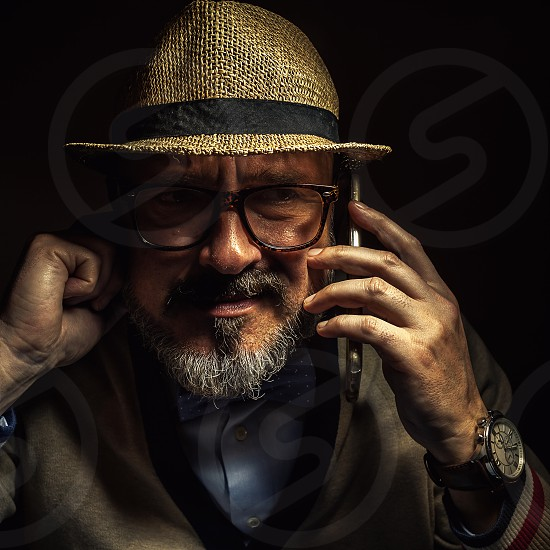 A person with glasses in classical clothes expressing his conclusion.  photo