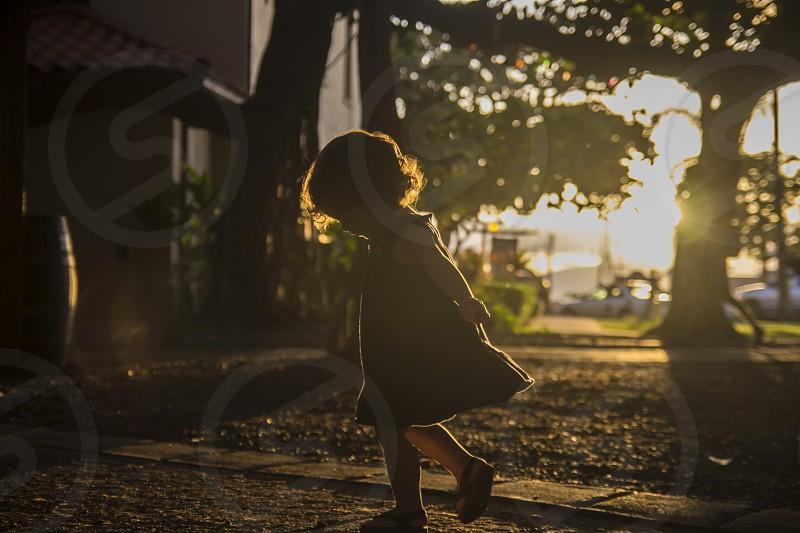 spinning twirling sunset silhouette child toddler kid fun photo