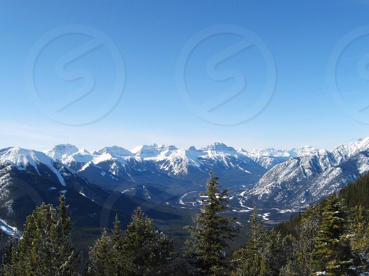 A landscape shot of the Rocky Mountains in Banff Alberta Canada. photo