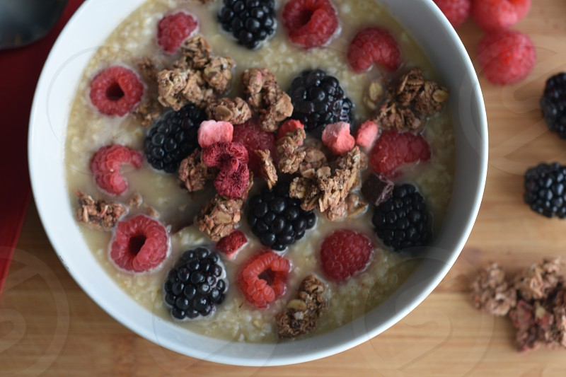 Healthy breakfast berries oatmeal yogurt frozen berry low-fat eating after exercise photo