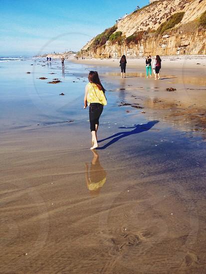 girl in yellow tank top walking photo