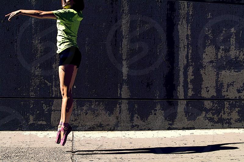 Ballerina Dancer Wall Sidewalk Alley Woman Bright Colors Contrast Shadow photo
