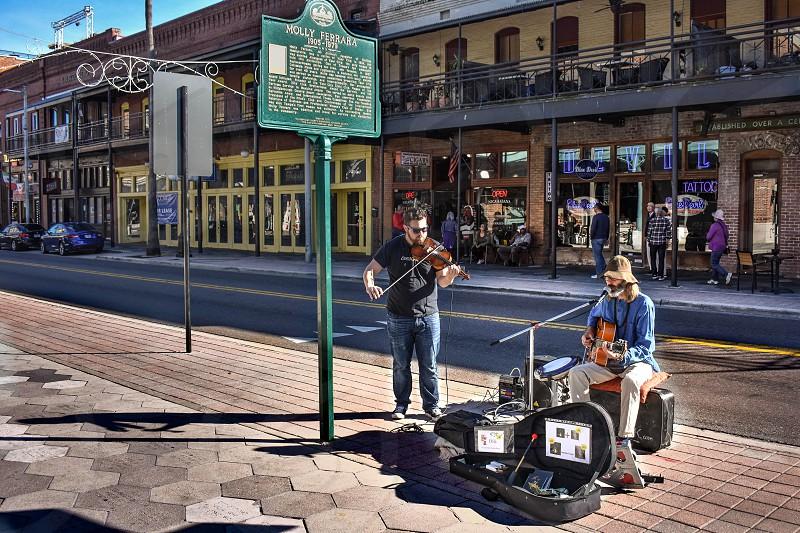 Ybor City Tampa Bay Florida. January 19  2019  Guitarist and violinist in 7th Ave (La Septima). photo