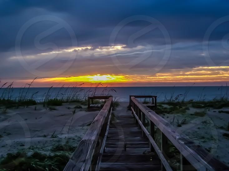 walkway to beach beach sunrise photo