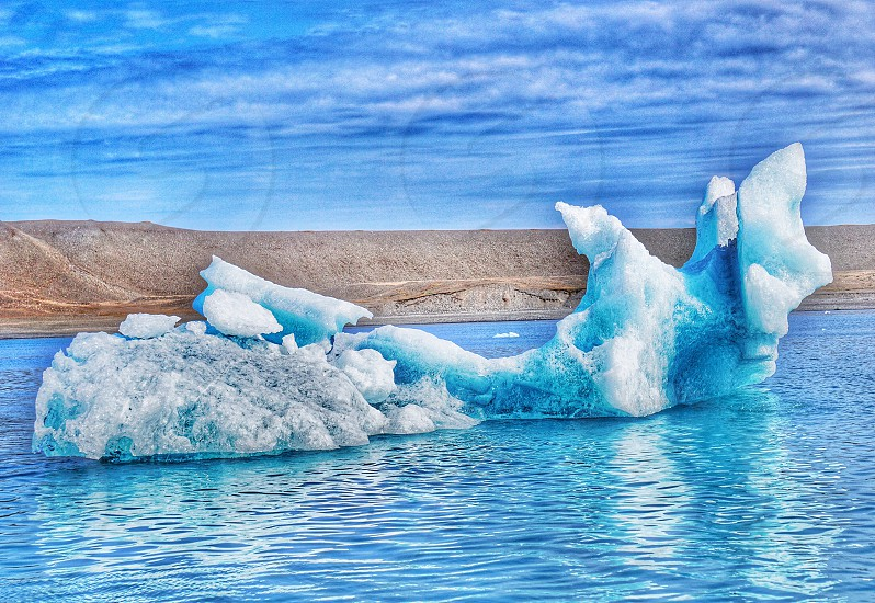 Iceland ice glacier lagoon water blue ocean sea cold nature landscape photo